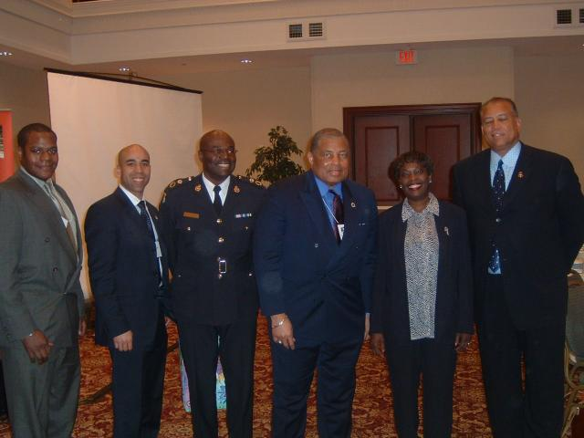 William Greer and Jean-Luc Morin,Montreal law enforcers, Deputy OPP Director Jay Hope and NOBLE's Clarence Edwards