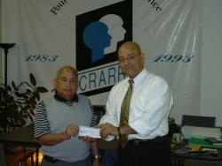 Cecilio Rous presenting a donation to Fo Niemi